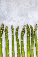 Asparagus on a concrete background