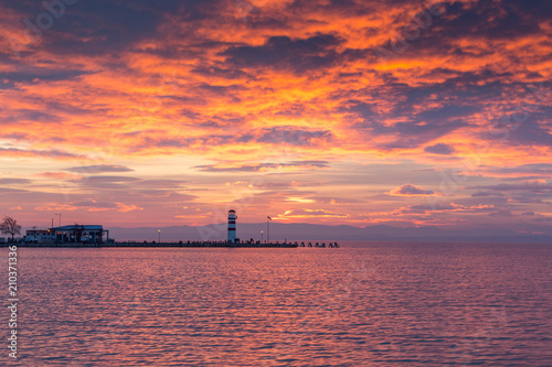 Plexiglas Vuurtoren Lighthouse in Podersdorf am See at winter sunset, lake Neusiedler See, Burgenland, Austria
