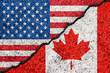 Flags of USA and Canada painted on cracked grunge wall background/Canada and USA relations concept