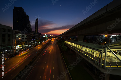 Fototapeta surreal sunset sky and traffic light tail