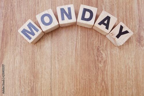 monday wooden letter alphabet on wooden background