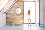 Attic wooden bathroom interior, sink, woman