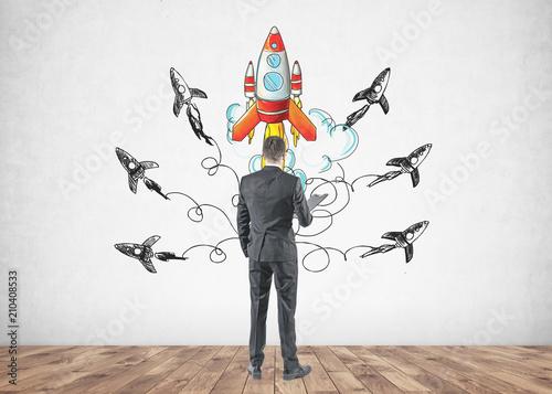 Leinwanddruck Bild Businessman with a folder, rear view, start up