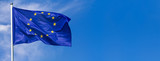 Flag of the European Union waving in the wind on flagpole against the sky with clouds on sunny day, banner, close-up - 210414987