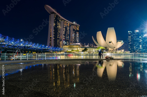MARINA BAY, SINGAPORE - OCT 7, 2017: Blue hour with Singapore Art Science Museum, Marina Bay Sands Hotel and Helix Bridge. These trio buildings had become landmark for Marina Bay, Singapore.