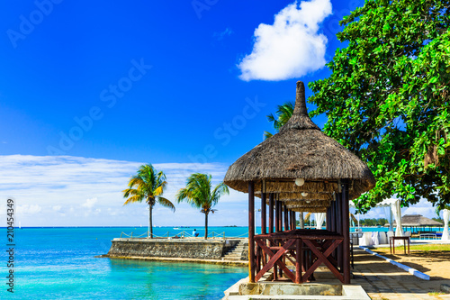 Plexiglas Freesurf Luxury vacation in tropical resort. Mauritius island. Beachside restaurant