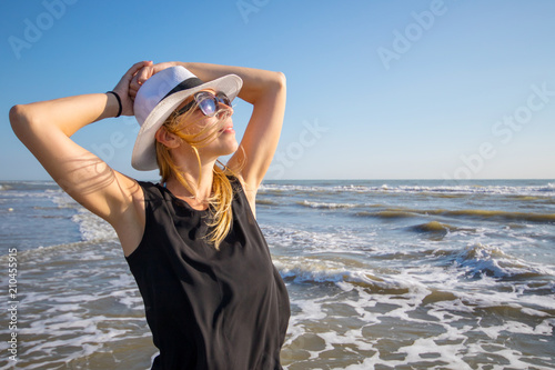 portrait of beautiful woman to the sea