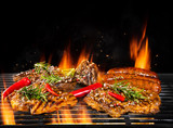 Various meat being grilled, isolated on black
