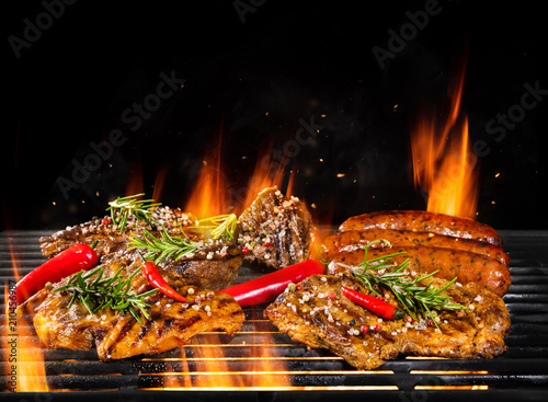Various meat being grilled, isolated on black - 210456987