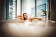 Leinwanddruck Bild - Beautiful woman taking hot bath in a luxury bathroom