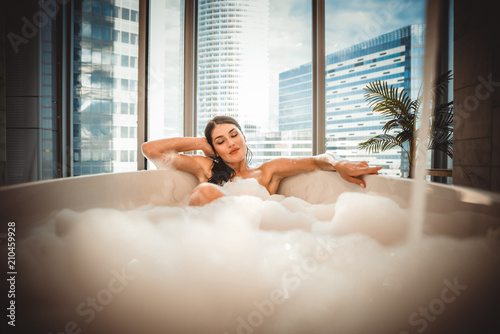 Leinwanddruck Bild Beautiful woman taking hot bath in a luxury bathroom