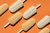 Varying  popsicles on an orange background. Flat lay of ice creams  in pop-art style. Horizontal  format