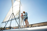 Two active men preparing sail of yacht while going to have small voyage in the sea - 210463719