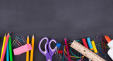 School Supplies on a Blackboard Background - 210488729