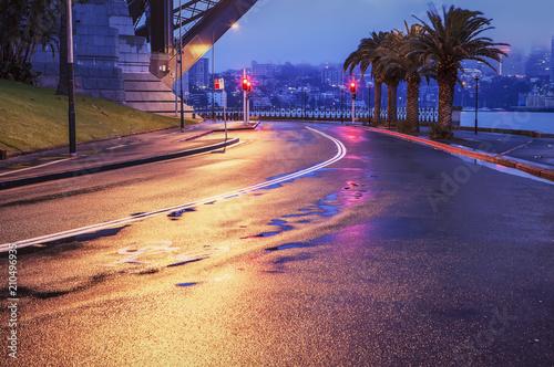 Empty wet street in Sydney dawn