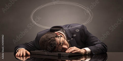 Leinwanddruck Bild Young businessman sleeping and dreaming at the office