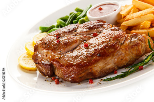 Grilled steak, French fries and vegetables - 210516390