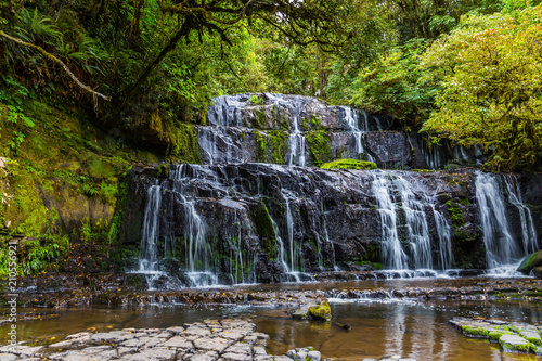 Picturesque waterfall in the forest - 210556921
