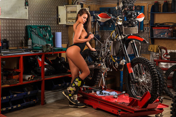 Girl repairing motorcycle