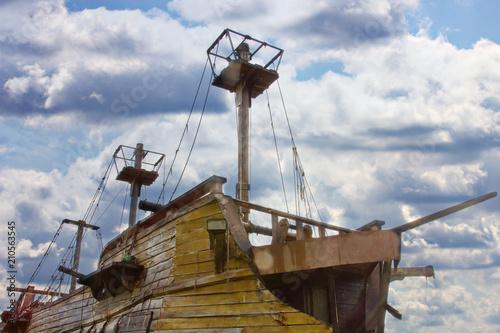 Fotobehang Schip Vintage wooden ship on a background of clouds