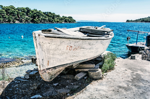 Aluminium Schip Old fishing boat with cracked white paint, Solta
