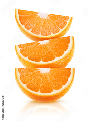 Leinwanddruck Bild Three wedges of orange fruit on top of each other isolated on white background with clipping path