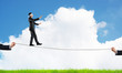 Leinwanddruck Bild - Business concept of risk support and assistance with man balancing on rope