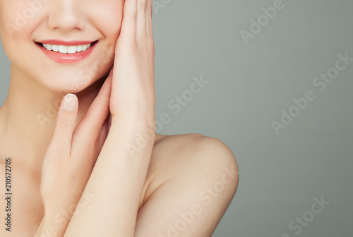 Perfect Female Smile with White Teeth on Grey Background