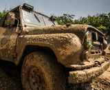 Deatil of muddy jeep car outdoor