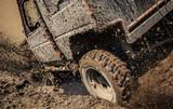 Jeep car splashing in muddy terrain