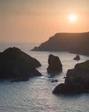Stunning vibrant sunset landscape image of Kynance Cove on South Cornwall coast of England - 210580566