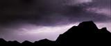 Powerful lightning storm raging in moody dramatic sky - 210580580
