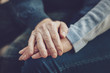 Real feelings. Close up of hands of nice elderly people being held together