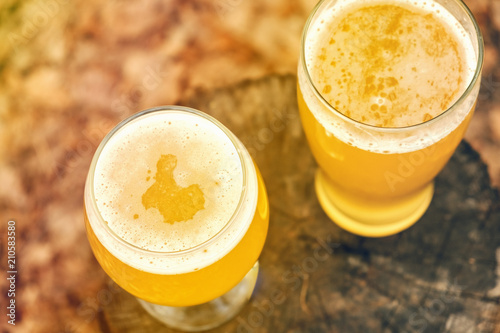 Fototapeta cold beer on desk and grill time, outdoor