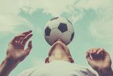 Happiness football player with ball and blue sky