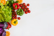 Fresh colorful organic vegetables on a white background, farming and healthy food concept. Copy space. Flat lay