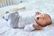 Newborn baby girl yawning