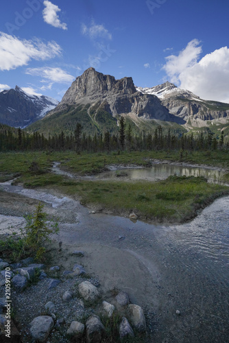 Portrait orientation mountain range landscape with blue sky