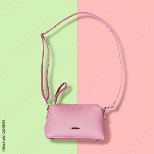 Ladies pink pastel handbag with long strap on pink background - 210619575