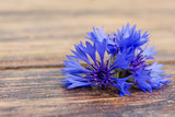 Cornflowers on a wooden background