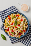 Italian fusilli pasta in a salad with ham and vegetables. - 210635947
