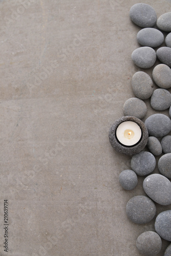 Aluminium Spa gray stones with white candle and grey background