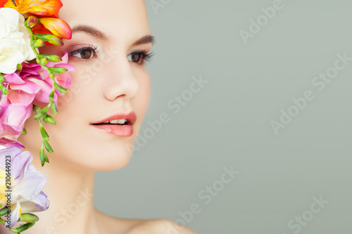 Fototapeta Beautiful Young Woman with Vivid Flowers. Spa Beauty, Aromatherapy and Skincare Concept