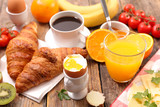 breakfast with coffee, egg, croissant and fruit - 210650704