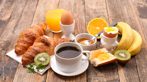 breakfast with coffee, egg, croissant and fruit - 210650715