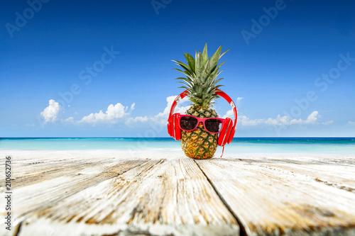 Leinwanddruck Bild Pineapple on beach and summer time
