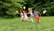 Leinwanddruck Bild - friendship, childhood, leisure and people concept - group of happy kids or friends playing tag game at birthday party in summer park