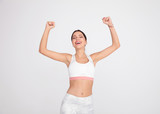 portrait of gym woman celebrating with hands in the air