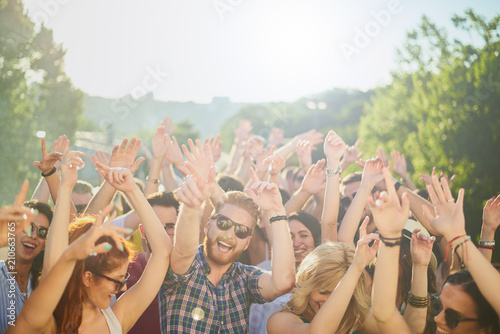 Group of people dancing and having a good time at the outdoor party/music festival - 210663765