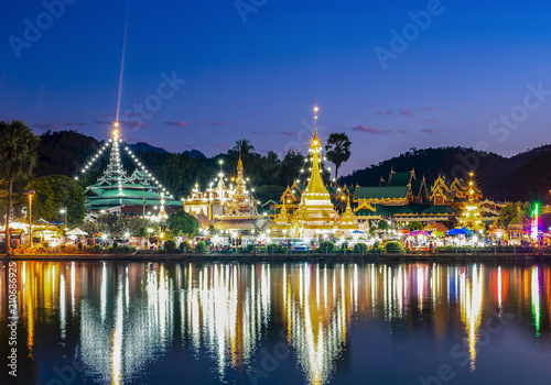 Plexiglas Bangkok Night time view of Temple across River in Thailand